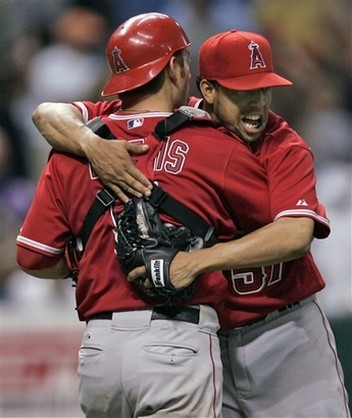 Francisco Rodriguez hugs Jeff Mathis after completing a save.jpg