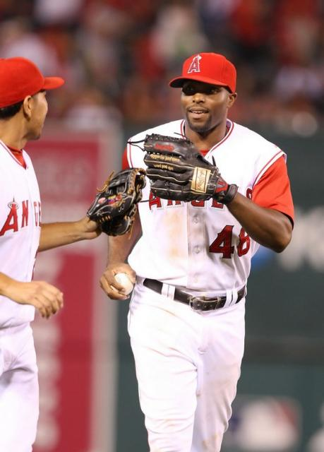 Torii Hunter is congratulated by Juan Riviera.jpg