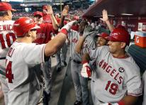 Angels teammates congratulate Mike Napoli.jpg