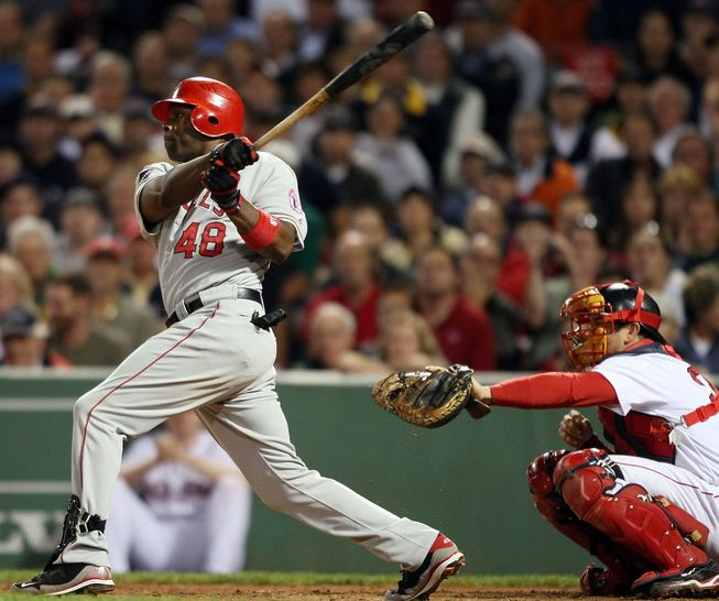 Torii Hunter gets a base hit against the Red Sox.JPG