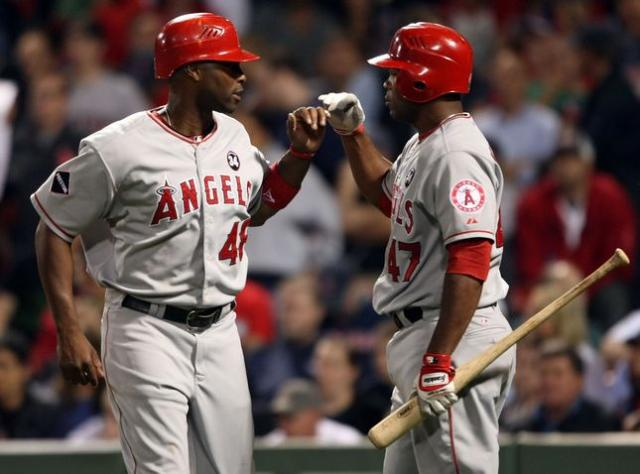 Torii Hunter gets congratulations from Howie Kendrick.JPG