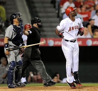 Torii Hunter lets go of his bat as he watches his home run.JPG
