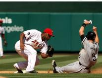 Howie Kendrick prepares to tag out Gordon Beckham.JPG