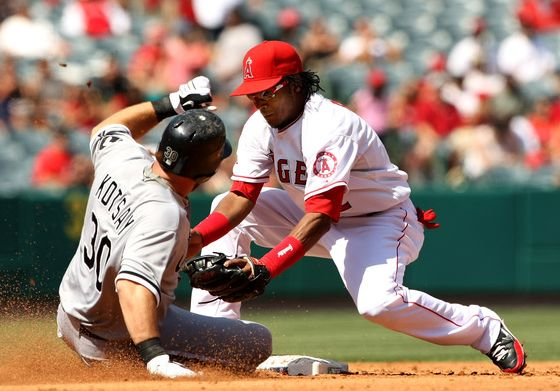 Erick Aybar tags out the runner at second base.JPG