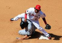 Erick Aybar avoids the runner and tries to complete the double play.JPG