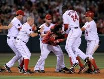 Erick Aybar is mobbed by teammates after getting the game winning hit.JPG