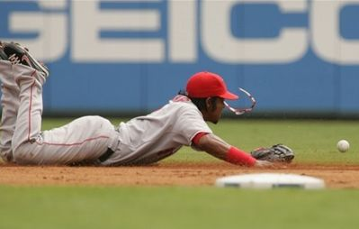 Erick Aybar loses his shades as he dives for the ball.JPG