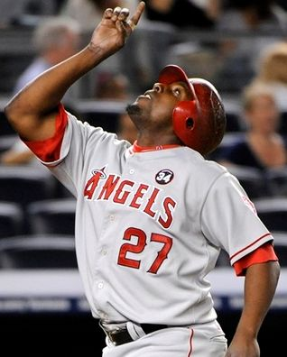 Vladimir Guerrero points to the sky after driving in the series winning RBI vs the Red Sox.JPG