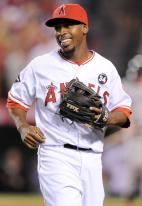 Chone Figgins smiles and walks off the field.JPG