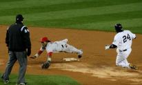 Erick Aybar tries to make a diving stop of an errant throw.JPG