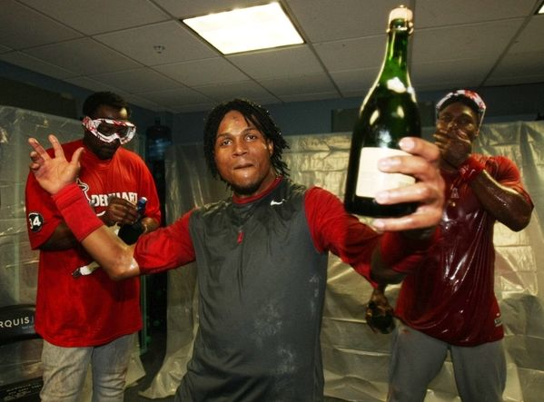 Erick Aybar holds up a champagne bottle in the 2009 NLDS locker room celebration in Boston.JPG