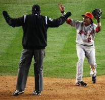 Erick Aybar argues with the second base umpire.JPG