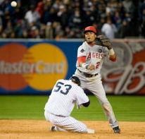 Erick Aybar throws to first as a Yankee tries to break up the double play.JPG