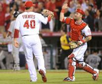 Brian Fuentes gets congratulations from Mike Napoli.JPG