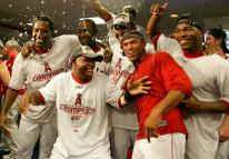 angels team celebrate 2007 playoff clinching win in clubhouse.jpg
