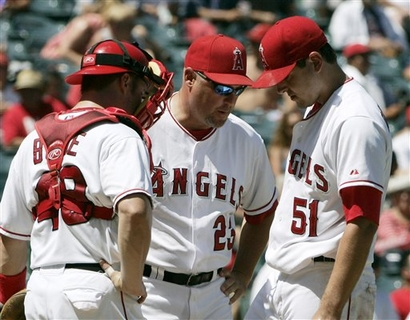 budde-mike-butcher-joe-saunders-capt. .athletics_angels_baseball_ans108.jpg