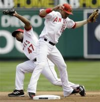howie kendrick and orlando cabrera reach for ball.jpg