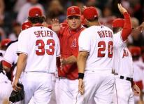team-congratulate-capt. .mariners_angels_baseball_ans119.jpg