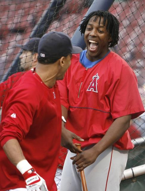 vlad guerrero has a laugh with julio lugo fullj.getty-77033958jr001_alds_los_ange.jpg