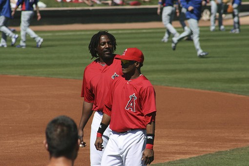 Erick Aybar with Vladamir Guerrero in the background.jpg