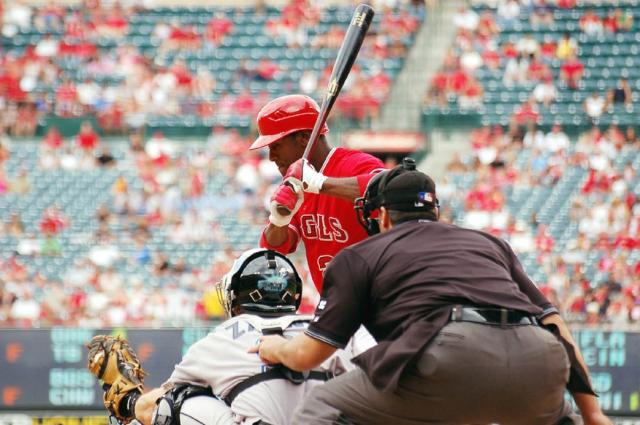 Aybar looks at a pitch low and away.jpg