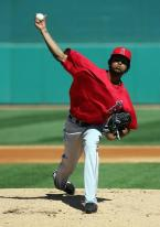 Ervin Santana strides forward and pitches.jpg