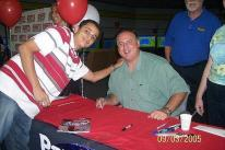 Mike Scioscia takes a photo with a fan.jpg
