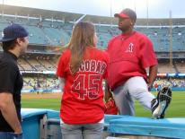 Kelvim Escobar chats with fans as he stretches.jpg