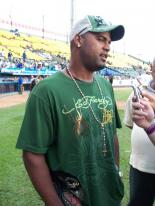 Kelvin Escobar in green hat and shirt.jpg