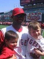 Escobar takes a photo with two little Angels fans.jpg