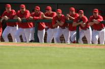 Angels players lean on the dugout railing.jpg