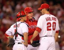 Garland talks to Mike Scioscia and Matthis on the mound.jpg