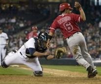 Maicer Izturis checks with the umpire to make sure he was called safe.jpg