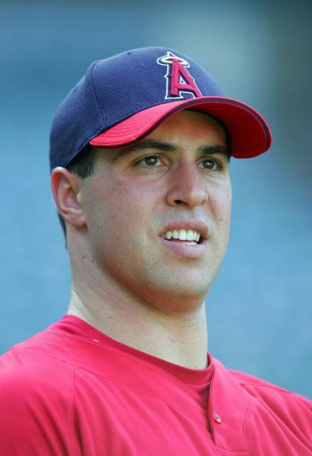 Mark Teixeira looks on in an Angels cap and uniform.jpg